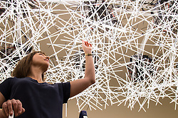 "Somerset House, London, September 21st 2015. Pictured: A woman adjusts ""Transparency; Warm/Wet"" designed by Melkan Gursel of Tabanlioglu Architects at Somerset House as part of the London Design Festival which runs between September 19th and 27th with a series of artworks and installations created through the collaborations of internationally renowned designers and brands.  // Contact: paul@pauldaveycreative.co.uk Mobile 07966 016 296"
