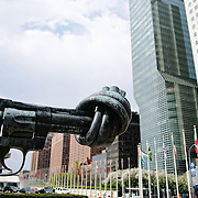 Carl Fredrik Reutersward's sculpture Non violence knotted gun sculpture with barrel tied in a knot signifying peace and disarmament in front of the United Nations in New York City. This sculpture was a gift from the Luxembourg government
