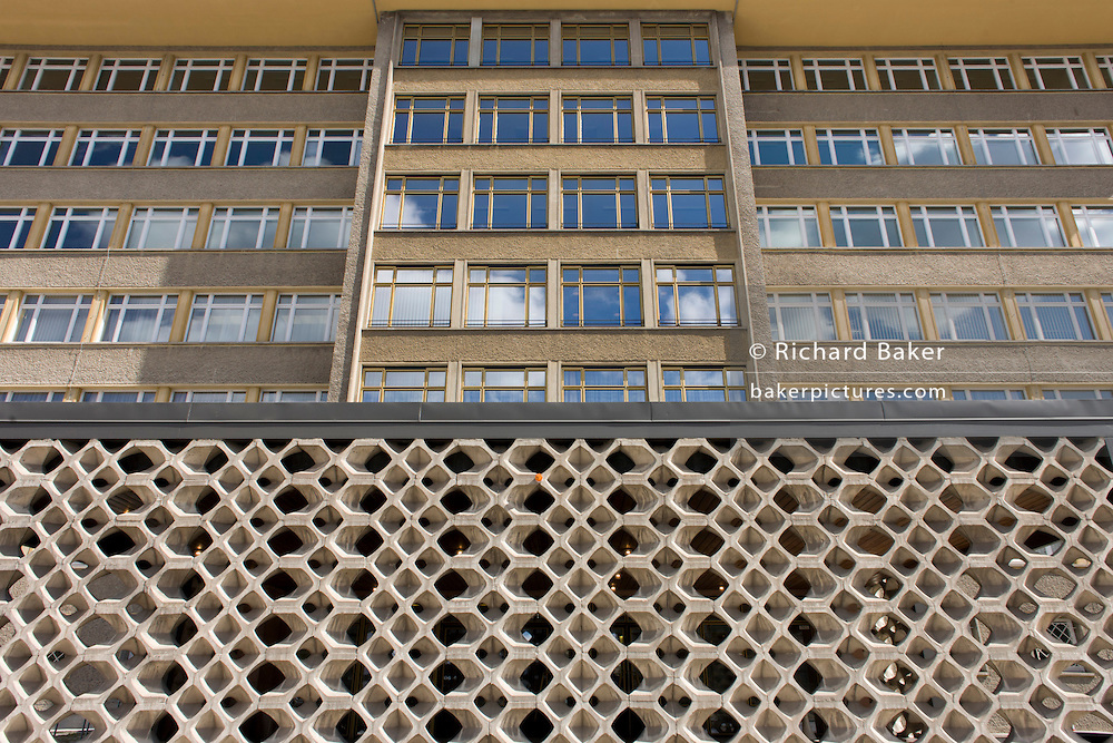 Exterior of 'Haus 1' the ministerial headquarters of the Stasi secret police in Communist East Germany, the GDR. Built in 1960, the complex now known as the Stasi Museum. Before the fall of the Wall, it was a 22-hectare complex of espionage whose centrepiece is the office and working quarters of the former Minister of State Security, Erich Mielke who considered their role as the 'shield and sword of the party', conducting one of the world's most efficient spying operations against its political dissenters during its 40-year old socialist history. Between 1950 and 1989, the Stasi employed a total of 274,000 people in an effort to root out the class enemy. During Hitler's Third Reich, the Gestapo had one agent for every 2,000 citizens whereas the Stasi had approximately an spy for every 6.5. Here at the Stasi HQ alone 15,000 were employed plus the many regional stations. German media called East Germany 'the most perfected surveillance state of all time' - administered from this complex of offices.