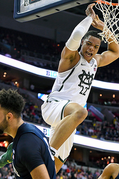 WASHINGTON, DC - MARCH 09:  Michigan State Spartans guard Miles Bridges (22) scores on a dunk over Penn State Nittany Lions forward Payton Banks (0) in the second round of the Big 10 Tournament game between the Michigan State Spartans and the Penn State Nittany Lions on March 9, 2017, at the Verizon Center in Washington, DC.  The Michigan State Spartans defeated  the Penn State Nittany Lions, 78-51.