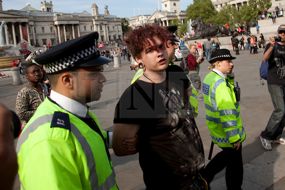 © under licence to London News Pictures. 01/05/2011. After the official Trade Union March finishes, some protesters remain in Trafalgar Square and upset the police. Protester LANCE GILHOOLY is taken away by the Police for allegedly defacing the London 2012 Countdown Clock in Trafalgar Square although one demonstrator was adament that he hadn'd done it. Photo credit should read BETTINA STRENSKE/LNP