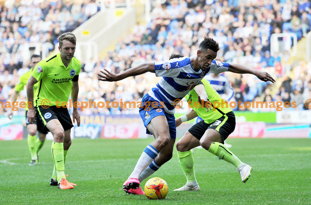 Nick Blackman of Reading gets at the Brighton defence during the Sky Bet Championship match between Reading and Brighton and Hove Albion at the Madejski Stadium in Reading. October 31, 2015.<br /> Simon  Dack / Telephoto Images<br /> +44 7967 642437