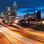 The Atlanta skyline is seen at dusk.