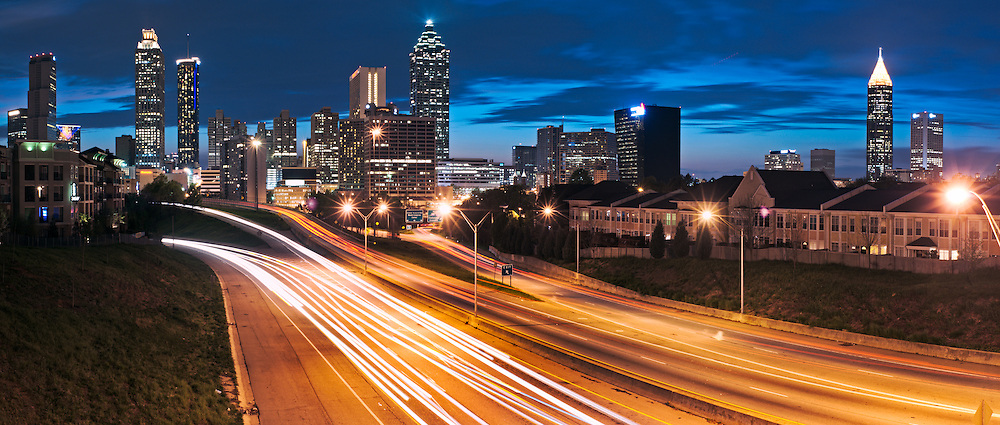 The Atlanta skyline is seen at dusk.