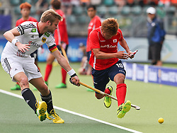 Hockey World Cup 2014<br /> The Hague, Netherlands <br /> Day 10 Men Korea v Germany<br /> Hyosik You of Korea and Maximillian Muller (L)<br /> Photo: Grant Treeby<br /> www.treebyimages.com.au