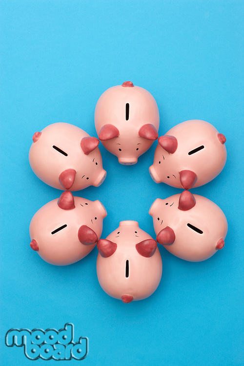 Piggy banks on blue background view from above