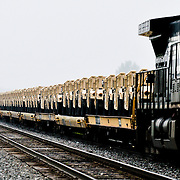 Humvees for military use are carried by train in Northern Indiana, May 18, 2010.