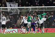 Dominic Iorfa (27) gets ahead of George Evans (17) heads wide during the EFL Sky Bet Championship match between Derby County and Sheffield Wednesday at the Pride Park, Derby, England on 11 December 2019.