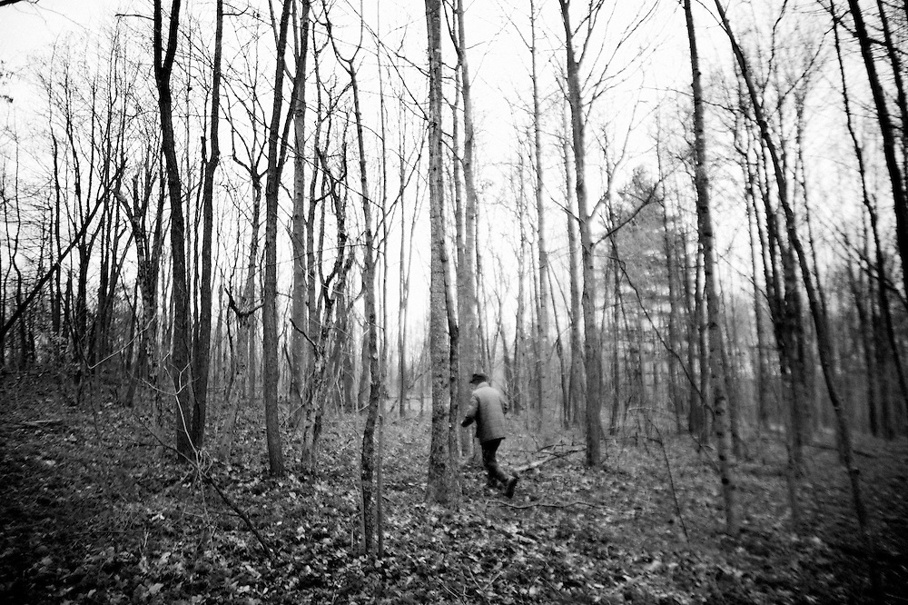Ed Perkins walks through the woods near his farm in New Marshfield, OH on February 11, 2008. Ed is a sustainable living farmer who heats his house with wood from his farm and sells his produce at the local Farmer's Market in Athens, OH.