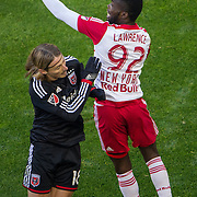 Nov 8, 2015; Harrison, NJ, USA; New York Red Bulls defender Kemar Lawrence (92) heads the ball defended by D.C. United forward Chris Rolfe (18) during the first half of the MLS Playoffs at Red Bull Arena. Mandatory Credit: William Hauser-USA TODAY Sports