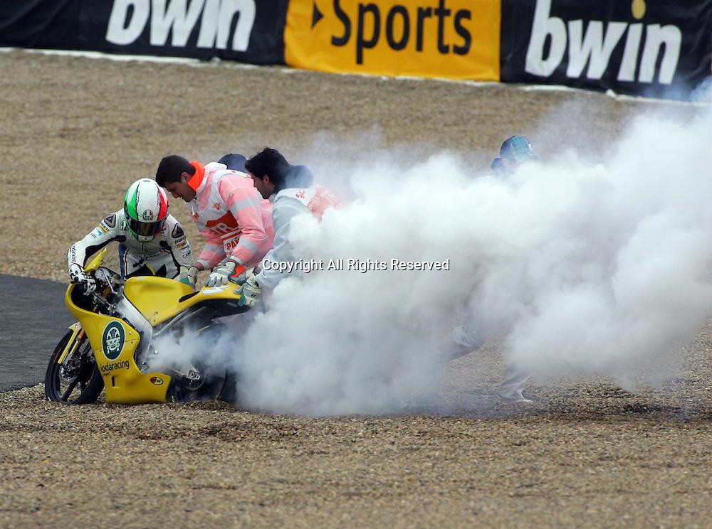29.04.2012. Jerez, Spain. Gran Premio Bwin de España. Moto3. Picture shows Luigi Maciano who crashed into the sand and his bike blew