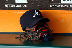 SAN FRANCISCO, CA - MAY 13:  Detailed view of a Atlanta Braves baseball hat and a baseball glove in the dugout before the game against the San Francisco Giants at AT&T Park on May 13, 2014 in San Francisco, California.  The San Francisco Giants defeated the Atlanta Braves 4-2.  (Photo by Jason O. Watson/Getty Images) *** Local Caption ***