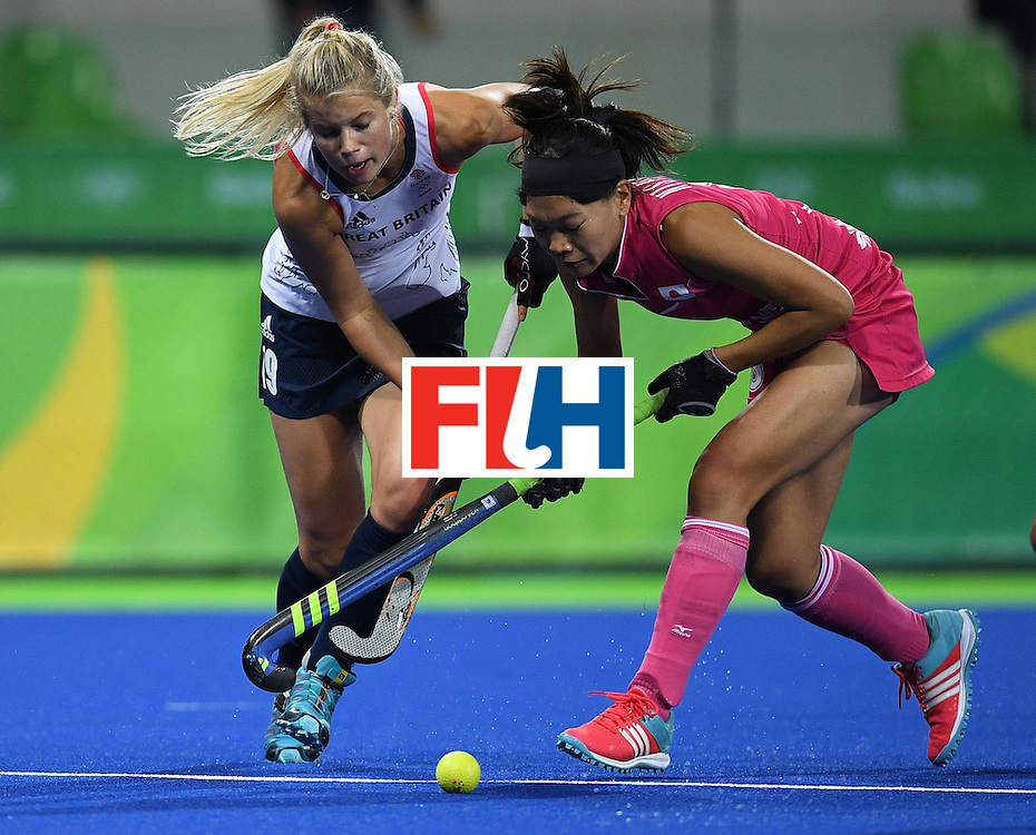 Britain's Sophie Bray vies for the ballwith Japan's Ayaka Nishimura during the women's field hockey Japan vs Britain match of the Rio 2016 Olympics Games at the Olympic Hockey Centre in Rio de Janeiro on August, 11 2016. / AFP / MANAN VATSYAYANA        (Photo credit should read MANAN VATSYAYANA/AFP/Getty Images)
