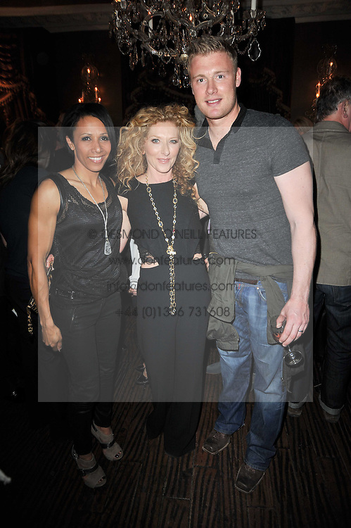 Left to right, DAME KELLY HOLMES, KELLY HOPPEN and FREDDIE FLINTOFF at a party to celebrate the publication of her new book - Kelly Hoppen: Ideas, held at Beach Blanket Babylon, 45 Ledbury Road, London W11 on 4th April 2011.
