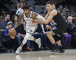 March 1, 2018 - Sacramento, CA, USA - The Brooklyn Nets' D'Angelo Russell, left, drives against the Sacramento Kings' Bogdan Bogdanovic in the first quarter at the Golden 1 Center in Sacramento, Calif., on Thursday, March 1, 2018. (Credit Image: © Hector Amezcua/TNS via ZUMA Wire)