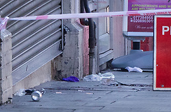 © Licensed to London News Pictures. 06/07/2019. London, UK. Blood and medical gloves are seen on the Harrow Road near Wembley Stadium after a man was shot on Friday night. The victim, believed to be a man in his 30s, was found with fatal gun shot wounds at 8pm near a mosque. No arrests have so far been made. Photo credit: Peter Macdiarmid/LNP
