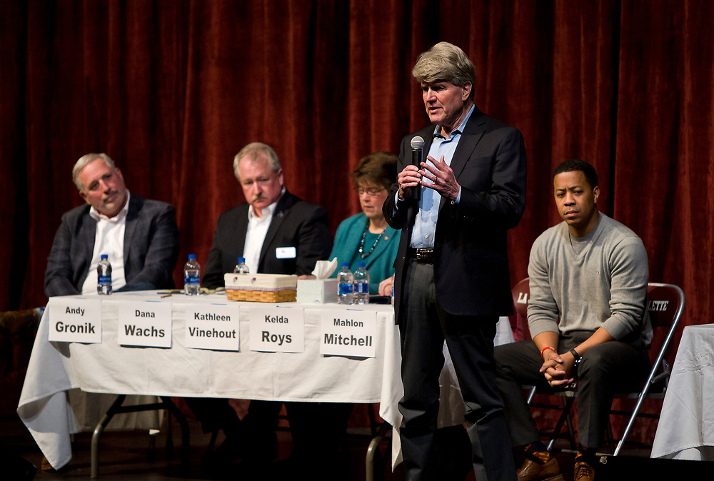 Matt Flynn makes his opening remarks during the public forum for Democratic gubernatorial candidates at LaFollete High School in Monona, Wisconsin., Sunday, Jan. 28, 2018.