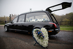 © Licensed to London News Pictures . 02/11/2015 . Liverpool , UK . Flowers by the hearse . The funeral of Police Constable Dave Phillips , at Liverpool Cathedral . Five people are charged in connection with his death , including Clayton Williams , 18 , from Wallasey , who is charged with murder . Photo credit: Joel Goodman/LNP