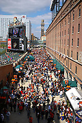 Fans fill the area in front of the warehouse before the start of opening day at Oriole Park at Camden Yards on Friday, April 9, 2010.