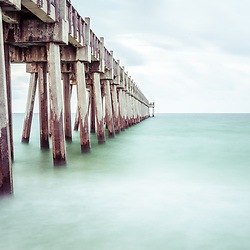 Pensacola Beach Florida Gulf Pier photo. Pensacola Beach is on Santa Rosa Island in the Emerald Coast region of the Southeastern United States of America. Copyright ⓒ 2018 Paul Velgos with All Rights Reserved.