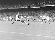 Down player just after he kicks the ball towards the Dublin goal mouth from just outside the box during the Kerry v Dublin All Ireland Senior Gaelic Football Final in Croke Park on the 24th of September 1978. Kerry 5-11 Dublin 0-9.