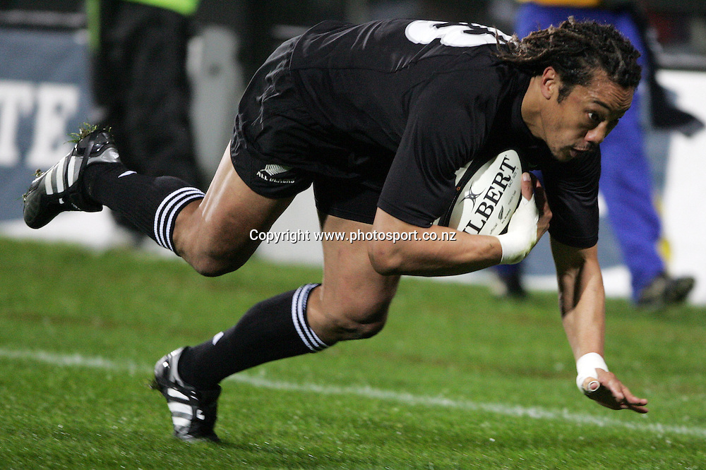 All Black captain Tana Umaga dives in for a try during the All Blacks v Fiji test match played at Albany Stadium in Auckland on Friday 10 June, 2005. The All Black won 91-0. Photo: Michael Bradley/PHOTOSPORT