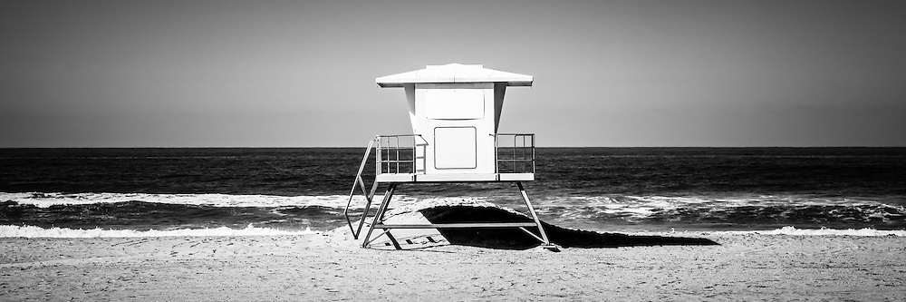 California lifeguard tower panoramic picture in black and white. Panoramic picture ratio is 1:3. The lifeguard tower is located in Huntington Beach Orange County Southern California. Photo is Copyright © 2012 Paul Velgos with All Rights Reserved.