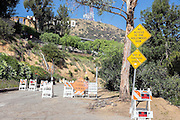 © Licensed to London News Pictures. 15/02/2015. Los Angeles, USA. An access road to the sign littered with road closed signs. Tourists photograph the Hollywood sign in Los Angeles, California. Photo credit : Stephen Simpson/LNP