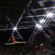 Gymnastics - Olympics: Day 10  Yilin Fan #323 of China performing her routine in the Women's Balance Beam Final during the Artistic Gymnastics competition at the Rio Olympic Arena on August 15, 2016 in Rio de Janeiro, Brazil. (Photo by Tim Clayton/Corbis via Getty Images)<br /> <br /> (Note to editors: A special effects starburst filter was used in the creation of this image)