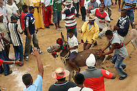 A Wayuu Indian boy rides a donkey that is being pushed to the finish line during a race that is part of the events at the annual Wayuu Cultural Festival in Uribia, Colombia June 10, 2007. (Photo/Scott Dalton)
