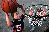 Rockport: Josh Sholds, 7, tries to dunk over his friend Mark Lovelace, 8, outside Mark's home on Seagull St. Tuesday afternoon. Many people across Cape Ann were outside taking advantage of the mild weather Tuesday..Photo by Mike Dean/Gloucester Daily Times Tuesday, February 19, 2008