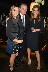 Left to right, JESSICA ENNIS-HILL, STEPHEN URQUHART and CINDY CRAWFORD at the OMEGA VIP dinner hosted by Cindy Crawford and OMEGA President Mr. Stephen Urquhart held at aqua shard', Level 31, The Shard, 31 St Thomas Street, London, SE1 9RY on 10th December 2014.
