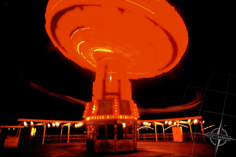 Spinning Swing Amusement Park Ride at night.