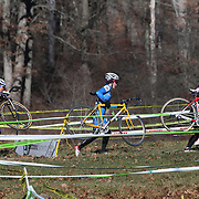 Rebecca Fahringer, (left) and Alice Henriques, (centre), in action during the Cyclo-Cross, Supercross Cup 2013 UCI Weekend at the Anthony Wayne Recreation Area, Stony Point, New York. USA. 24th November 2013. Photo Tim Clayton