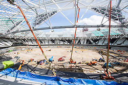 New lights are erected in The Olympic Stadium as it is refitted for legacy.Picture by David Poultney