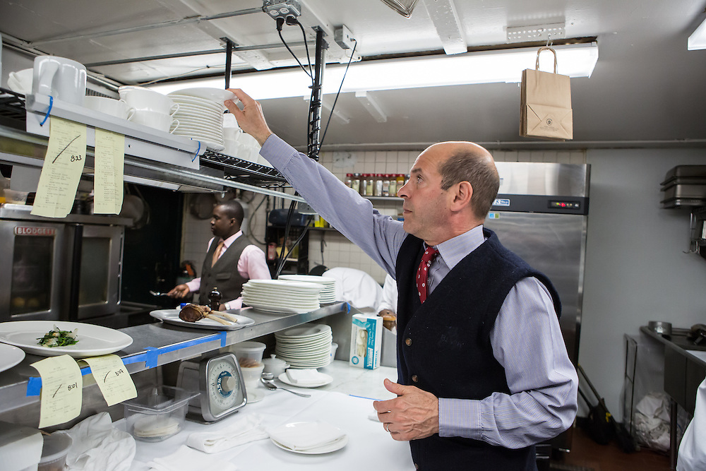 New York, NY - 27 May 2014. Owner Robert Margolis at work in the kitchen at The Simone.