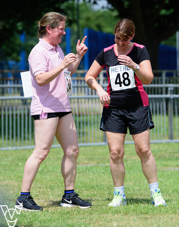 Metro Blind Sport's 2017 Athletics Open held at Mile End Stadium.  100m.  Odette Battarel, left, and Deborah Reynolds<br /> <br /> Picture: Chris Vaughan Photography for Metro Blind Sport<br /> Date: June 17, 2017