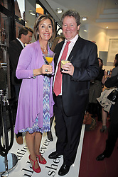 JAMES & FIONA COCKERAM he is President of Moet Hennessey Europe at a party to launch the new Belvedere Black Raspberry Maceration held at the Belvedere Black Raspberry Pop-up Store, 100 Mount Street, London W1 on 6th May 2009.