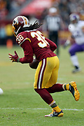 Washington Redskins free safety D.J. Swearinger (36) runs with the ball after intercepting a third quarter pass, his first of two interceptions on the day, during the 2017 NFL week 10 regular season football game against the Minnesota Vikings, Sunday, Nov. 12, 2017 in Landover, Md. The Vikings won the game 38-30. (©Paul Anthony Spinelli)