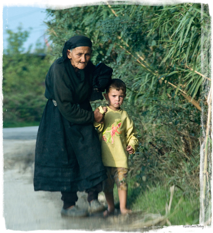 Black widow grandmother leading small boy