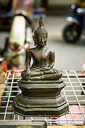 25 JUNE 2013 - BANGKOK, THAILAND:     A Buddha statue for sale in the Amulet Market in Bangkok. The market is adjacent to Wat Mahathat, between Maharat Road and the Chao Phraya River.    PHOTO BY JACK KURTZ