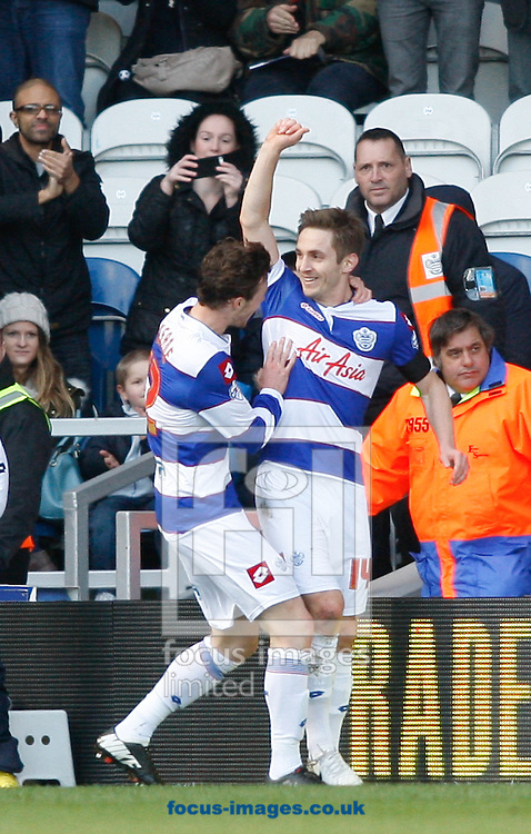 Kevin Doyle of QPR (R) celebrates after scoring their first goal during the Sky Bet Championship match at the Loftus Road Stadium, London<br /> Picture by Andrew Tobin/Focus Images Ltd +44 7710 761829<br /> 16/02/2014