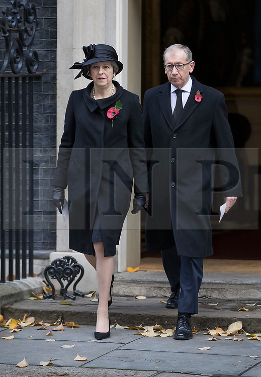 © Licensed to London News Pictures. 12/11/2017. London, UK. Prime Minister Theresa May and her husband Philip walk from Number 10 Downing Street to attend the Remembrance Sunday Ceremony at the Cenotaph in Whitehall. Photo credit: Peter Macdiarmid/LNP