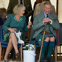 HRH The Prince Charles Duke of Rothesay  wearing a Hunting Stewart Tartan kilt and HRH Duchess of Rothesay  wearing Lord of the Isles Tartan watch the Mey Games at Mey (Caithness) Scotland Aug 4 2007