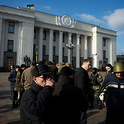 KIEV, UKRAINE - February 24, 2014: Members of Maidan's defence unit take guard outside Ukraine parliament building in Kiev. CREDIT: Paulo Nunes dos Santos