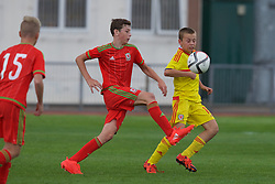 NEWPORT, WALES - Thursday, August 4, 2016: Regional Development Boys' Ollie James-Denham [L] and North Wales Academy Boys' Morgan Celt Williams during the Welsh Football Trust Cymru Cup 2016 at Newport Stadium. (Pic by Paul Greenwood/Propaganda)