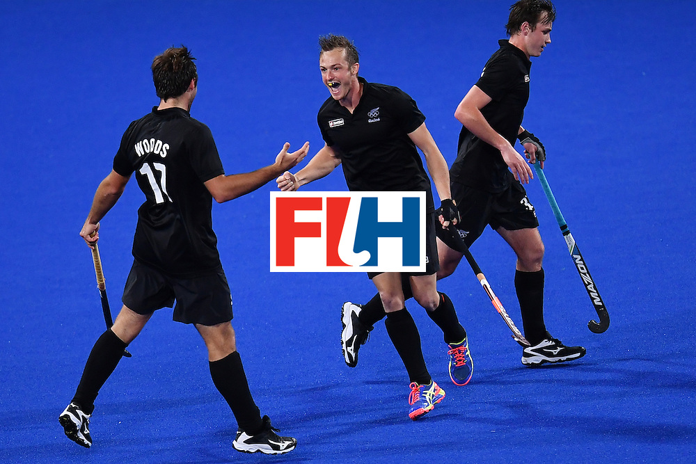 New Zealand's Hugo Inglis (C) celebrates scoring a goal with his teammates during the mens's field hockey Belgium vs New Zealand match of the Rio 2016 Olympics Games at the Olympic Hockey Centre in Rio de Janeiro on August, 12 2016. / AFP / MANAN VATSYAYANA        (Photo credit should read MANAN VATSYAYANA/AFP/Getty Images)