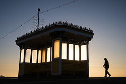 © Licensed to London News Pictures. 06/11/2017. Southsea, UK.  A man walking along the promenade during sunrise in Southsea this morning, 6th November 2017. Photo credit: Rob Arnold/LNP