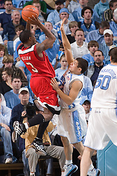 28 December 2006: Rutgers guard (3) Courtney Nelson shoots over North Carolina guard (22) Wes Miller during a 87-48 Rutgers Scarlet Knights loss to the North Carolina Tarheels, in the Dean Smith Center in Chapel Hill, NC.<br />