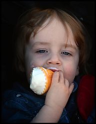 Isaac Parsons enjoys an Ice cream in the hot weather in Southend, United Kingdom. Sunday, 9th March 2014. Picture by Andrew Parsons / i-Images
